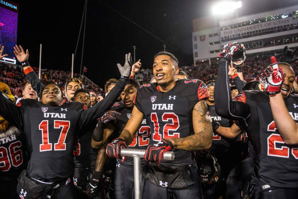 Chris Detrick  |  The Salt Lake Tribune Utah Utes wide receiver Tim Patrick (12) celebrates with his teammates after the game at Rice-Eccles Stadium Friday September 23, 2016. Utah Utes defeated USC Trojans 31-27. Patrick scored the game-winning touchdown.