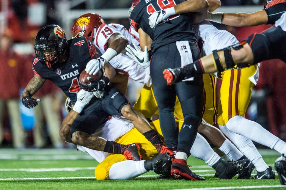 Chris Detrick     The Salt Lake Tribune Utah Utes running back Troy McCormick (4) is tackled by USC Trojans linebacker Michael Hutchings (19) during the first half of the game at Rice-Eccles Stadium Friday September 23, 2016.
