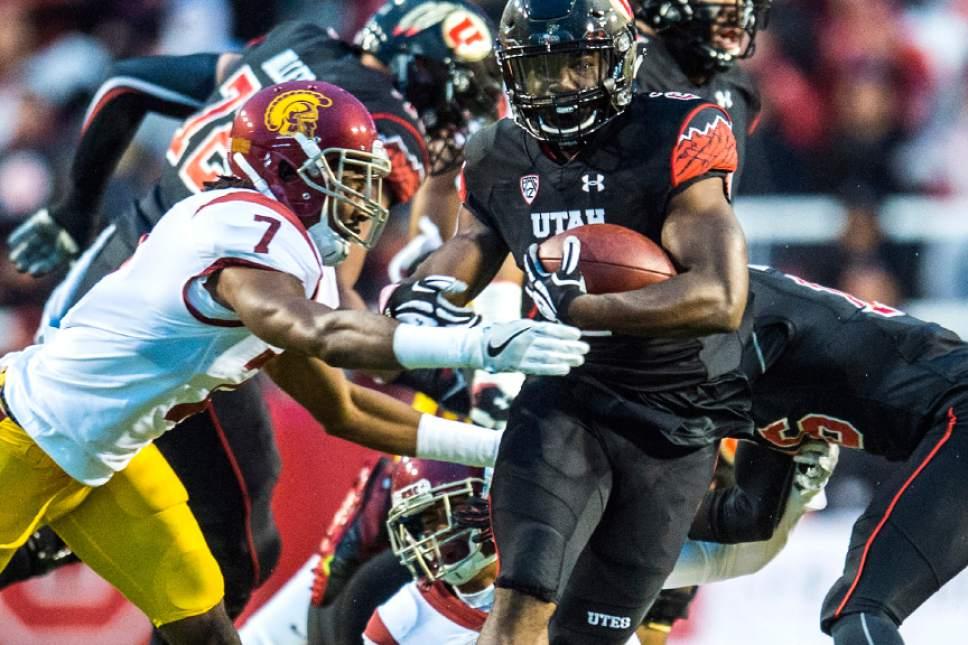 Chris Detrick     The Salt Lake Tribune Utah Utes running back Zack Moss (2) runs past USC Trojans defensive back Marvell Tell III (7) during the first half of the game at Rice-Eccles Stadium Friday September 23, 2016.