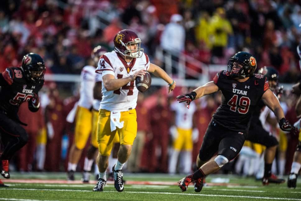Chris Detrick     The Salt Lake Tribune USC Trojans quarterback Sam Darnold (14) runs around Utah Utes defensive end Hunter Dimick (49) during the first half of the game at Rice-Eccles Stadium Friday September 23, 2016.