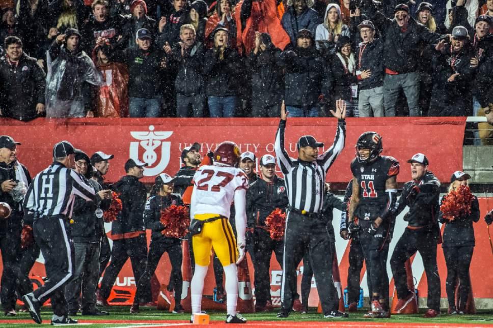 Chris Detrick     The Salt Lake Tribune Utah Utes wide receiver Raelon Singleton (11) celebrates after scoring a touchdown past USC Trojans running back Lance Mudd (27) during the game at Rice-Eccles Stadium Friday September 23, 2016. Utah Utes defeated USC Trojans 31-27.