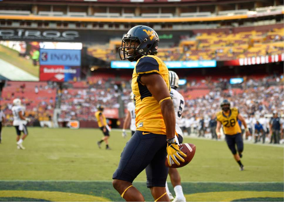 West Virginia wide receiver Daikiel Shorts reacts after catching a touchdown during the second half of an NCAA college football game against BYU, Saturday, Sept. 24, 2016, in Landover, Md. (AP Photo/Nick Wass)