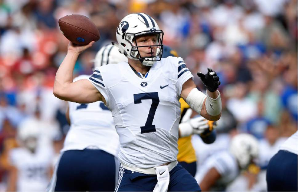 BYU quarterback Taysom Hill (7) passes during the first half of an NCAA college football game against West Virginia, Saturday, Sept. 24, 2016, in Landover, Md. (AP Photo/Nick Wass)