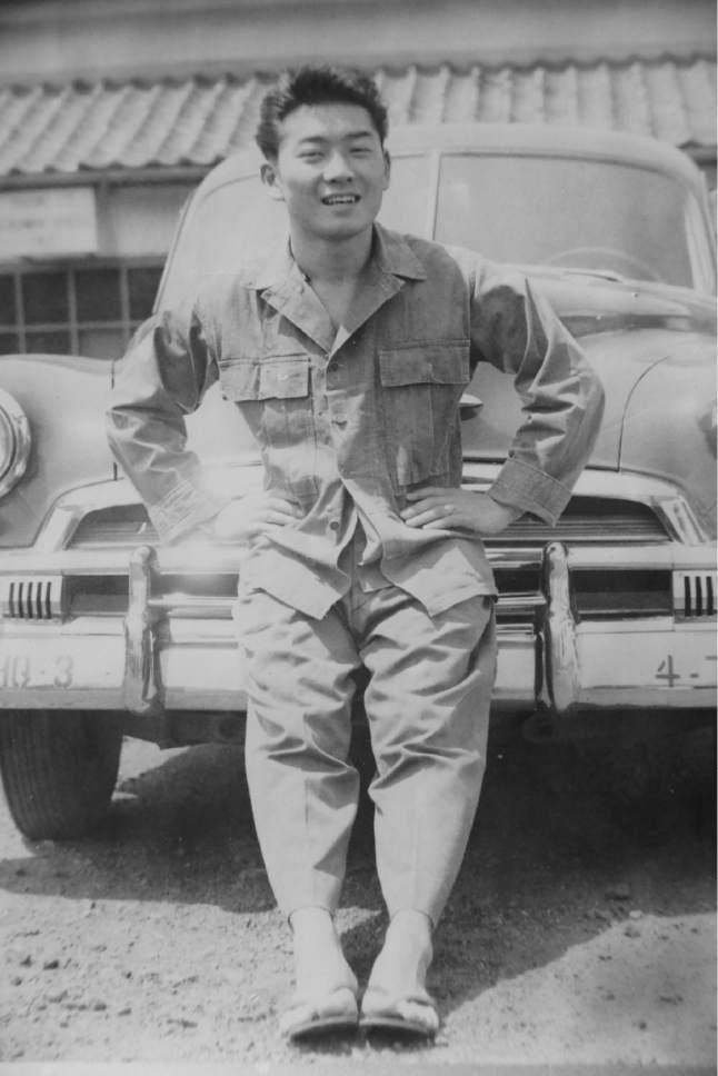 |  Courtesy Uno Family  Raymond Uno in the motor pool in Japan in 1950.