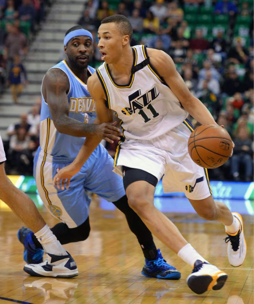 Steve Griffin  |  The Salt Lake Tribune  Utah Jazz guard Dante Exum (11) drives past Denver Nuggets guard Ty Lawson (3) during first half action in the Jazz versus Nuggets NBA game at EnergySolutions Arena in Salt Lake City, Wednesday, April 1, 2015.