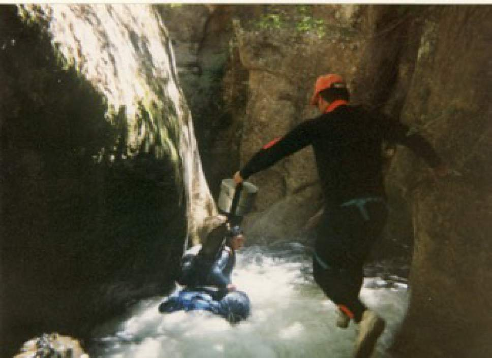 |  courtesy Noel de Nevers  Group leader Kim Ellis jumps while canyoneering through Kolob Canyon in July 1993. This picture inspired the cover design for Noel de Nevers' book.