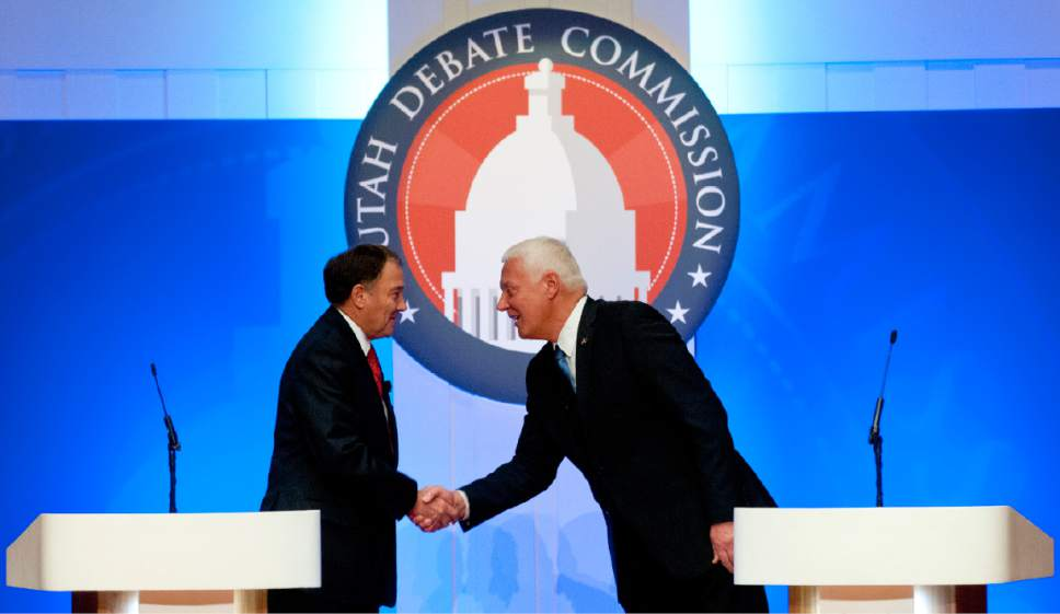 John Zsiray  |  Pool Photo  Utah Gov. Gary Herbert, left, shakes hands with challenger Mike Weinholtz prior to the gubernatorial debate at the Caine Performance Hall at Utah State University, Monday, Sept. 26, 2016, in Logan, Utah.
