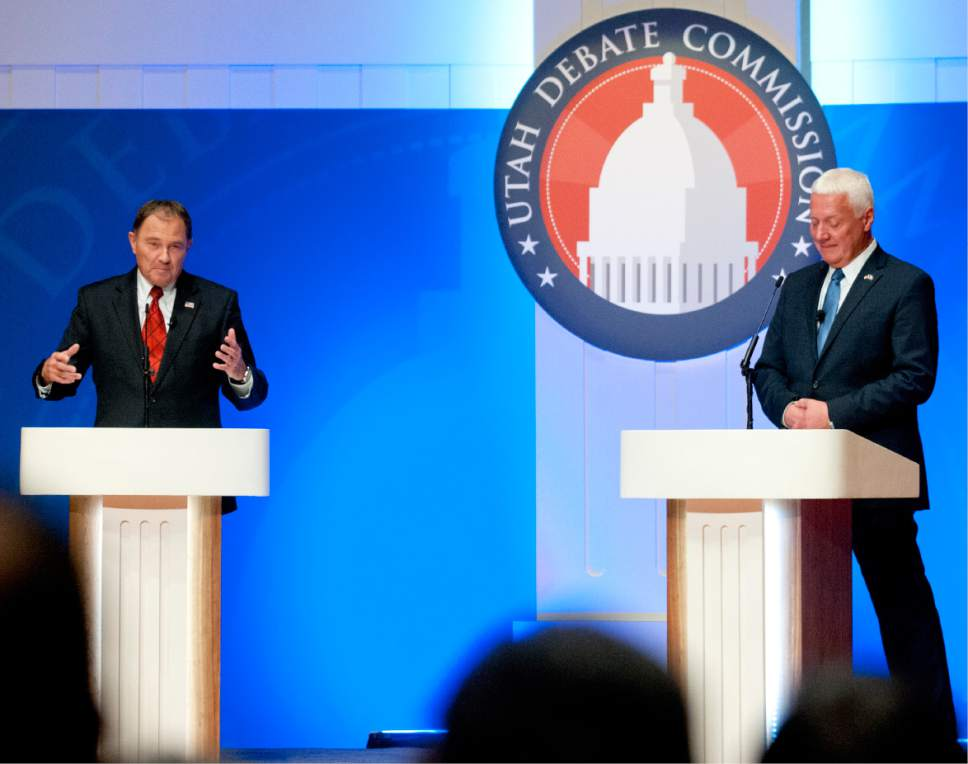 John Zsiray  |  Pool Photo  Utah Gov. Gary Herbert, left, answers a question as challenger Mike Weinholtz listens during a gubernatorial debate at the Caine Performance Hall at Utah State University, Monday, Sept. 26, 2016, in Logan, Utah.
