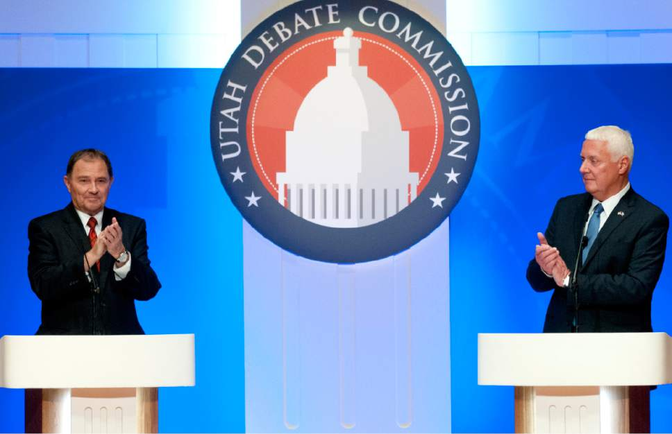 John Zsiray  |  Pool Photo  Utah Gov. Gary Herbert, left, and challenger Mike Weinholtz prior clap at the conclusion of their gubernatorial debate at the Caine Performance Hall at Utah State University, Monday, Sept. 26, 2016, in Logan, Utah.