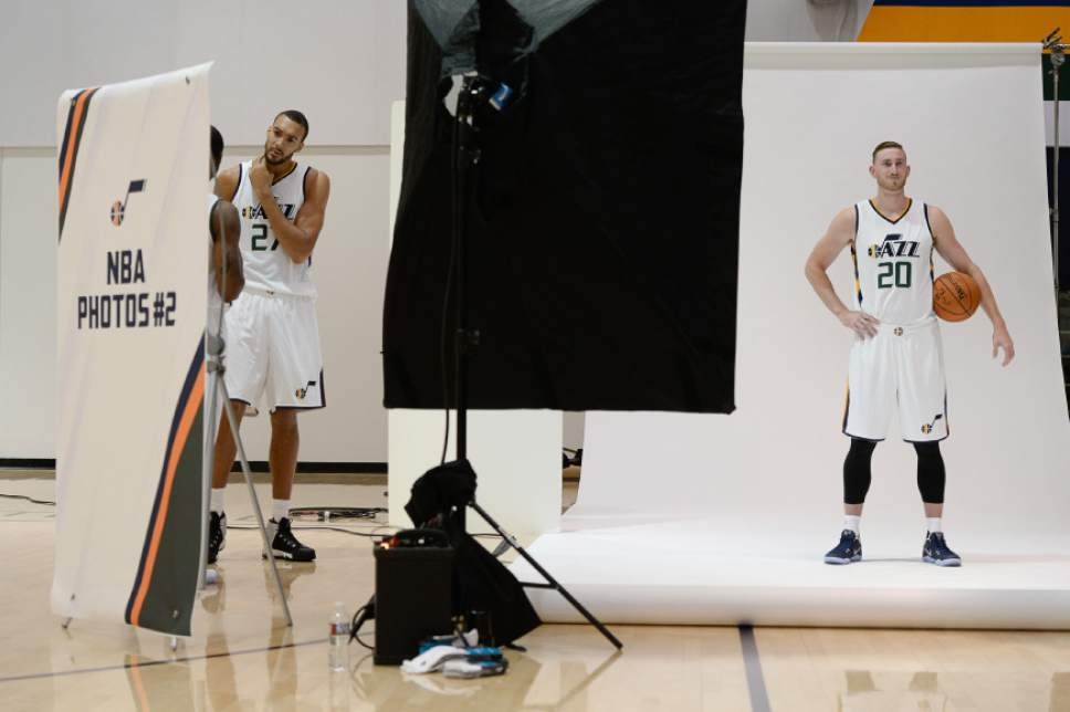 Francisco Kjolseth | The Salt Lake Tribune Rudy Gobert, left, and Gordon Hayward take their turn on the backdrop for the team photographer as the Utah Jazz opens training camp with media day for players at the team's training facility in Salt Lake on Monday, Sept. 26, 2016.