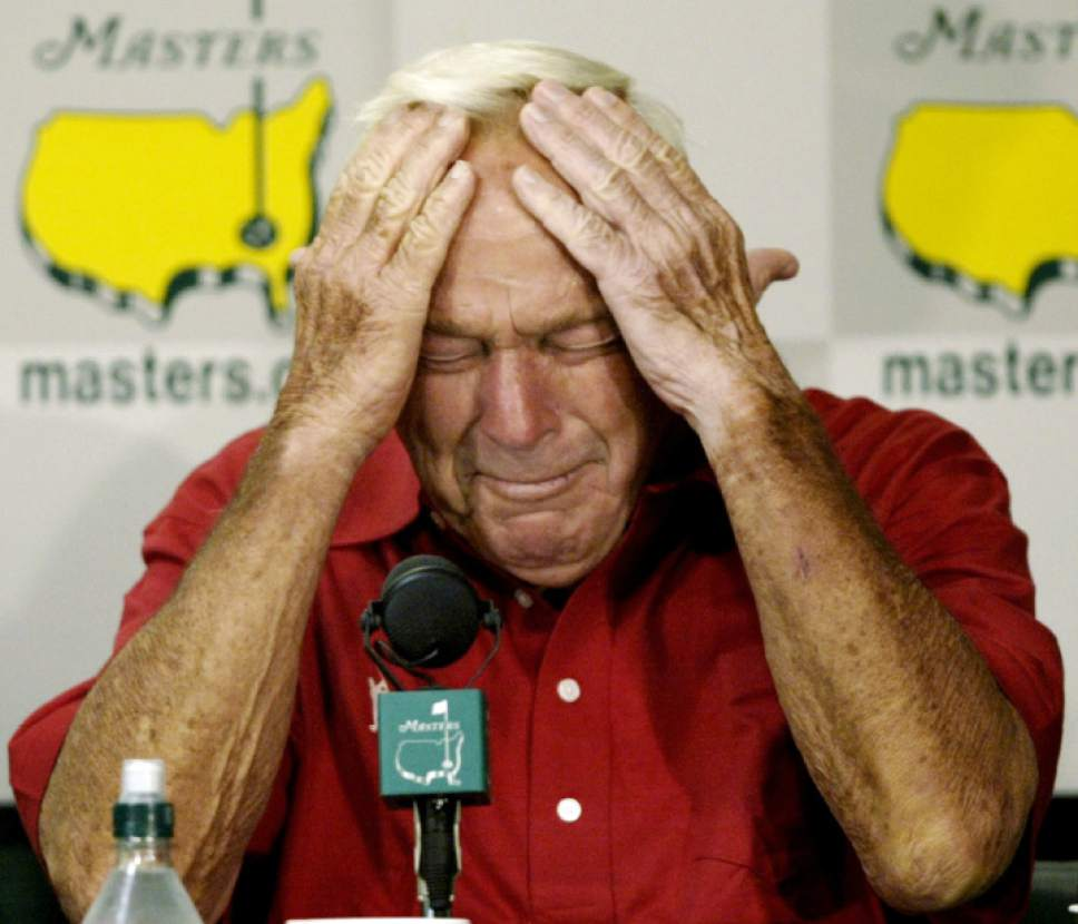 """File-This April 9, 2004, file photo shows four-time Masters champion Arnold Palmer reacting during his press conference after playing his final round of Masters competition at the 2004 Masters golf tournament at the Augusta National Golf Club in Augusta, Ga.  Palmer, who made golf popular for the masses with his hard-charging style, incomparable charisma and a personal touch that made him known throughout the golf world as """"The King,"""" died Sunday, Sept. 25, 2016, in Pittsburgh. He was 87.   (AP Photo/Amy Sancetta, File)"""