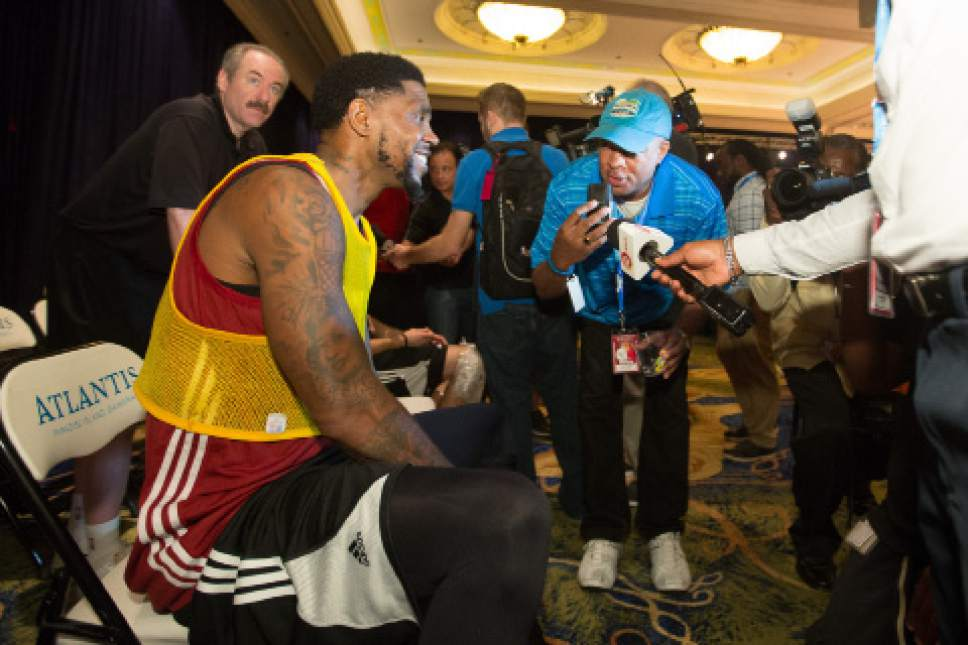 Miami Heat basketball player Udonis Haslem talks to the press during his team's training camp in Nassau, Bahamas, Tuesday, Sept. 27, 2016. The team arrived in the Bahamas on Monday for a week-long training session at the Atlantis, Paradise Island resort. (AP Photo/Tim Aylen)