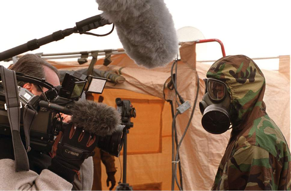 Tribune file photo  A crew from CNN interviews a soldier at Dugway's field demonstration on Dec. 8, 1997. Dugway demonstrated new technologies for sampling, detecting and detecting biological weapons.