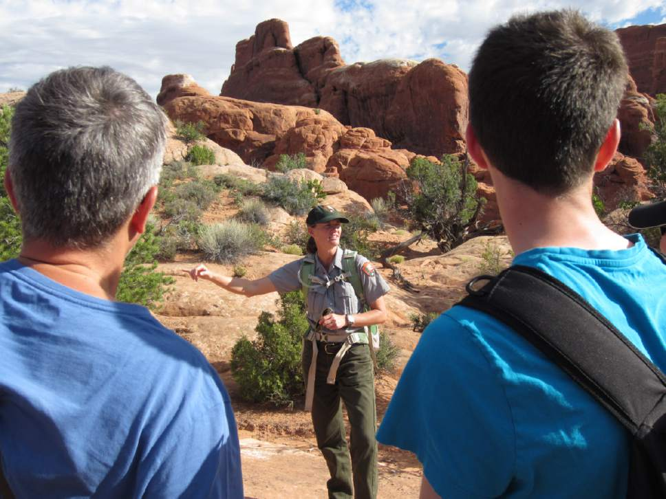 photo courtesy National Park Service  Park guide Allison VanLonkhuyzen, center, leads Arches National Park visitors through the Fiery Furnace, one of Utah's marquee hikes limited to just 125 visitors a day. The park is proposing to eliminate commercial guiding on this coveted hike, while continuing to allow it on 23 others. Photo courtesy National Park Service.