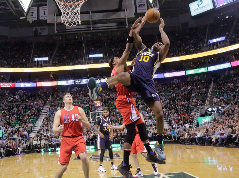 FILE - This Dec. 26, 2015, file photo, Los Angeles Clippers forward Paul Pierce, center, fouls Utah Jazz guard Alec Burks (10) during the second half of an NBA basketball game, in Salt Lake City. Burks injured his leg after falling following the foul. Burks is the third major contributor for the Jazz who has been lost for a significant amount of time this season. Starting center Rudy Gobert remains out with a sprained MCL. Starting point guard Dante Exum is out for the season with a torn ACL. (AP Photo/Rick Bowmer, File)