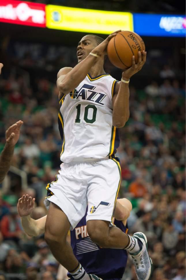 Rick Egan  |  The Salt Lake Tribune  Utah Jazz guard Alec Burks (10) goes in for a shot, in NBA action Phoenix Suns vs. The Utah Jazz, in Salt Lake City, Monday, December 21, 2015.
