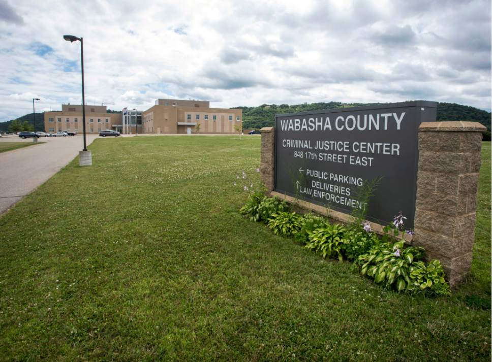 This July 11, 2016 photo shows the Wabasha County Criminal Justice Center in Wabasha, Minn., where authorities accessed information on civilians through law enforcement databases. The Minnesota Department of Public Safety said it changed the way officers access a state driver database after a 2013 legislative audit found over half of the 11,000 law enforcement who use it made searches that appeared questionable. The audit was conducted after a former state employee was charged with illegally viewing thousands of driver's-license records. (AP Photo/Bruce Kluckhohn)
