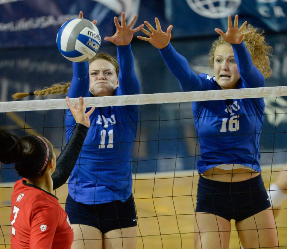 Francisco Kjolseth | The Salt Lake Tribune BYU's #11 Lacy Haddock and #16 Whitney Young Howard put the defensive pressure on Utah's Eliza Katoa in women's volleyball at the Smith Fieldhouse in Provo on Thursday, Sept. 15, 2016.