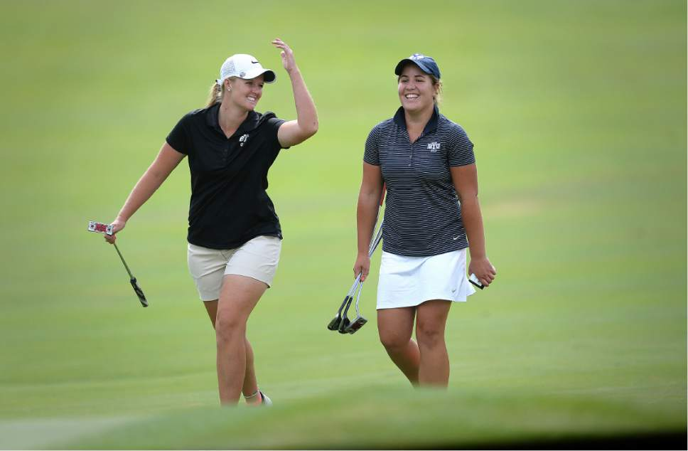 Scott Sommerdorf   |  The Salt Lake Tribune   Lea Garner, left, and Kendra Dalton laugh as they walk up to the 13th green during the 2016 Utah Women's State Amateur golf tournament at Victory Ranch Golf Club in Francis, Friday, August 5, 2016. Dalton won the match over Garner - both team mates at BYU.