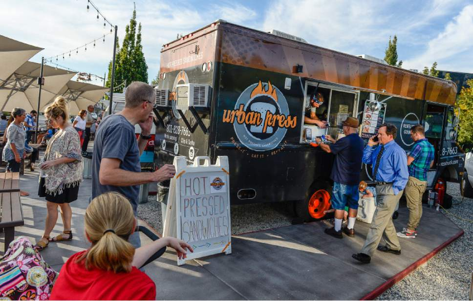Francisco Kjolseth | The Salt Lake Tribune The Urban Press Food Truck joins the pack of food trucks parked at the Soho Food Park in Holladay earlier this year.
