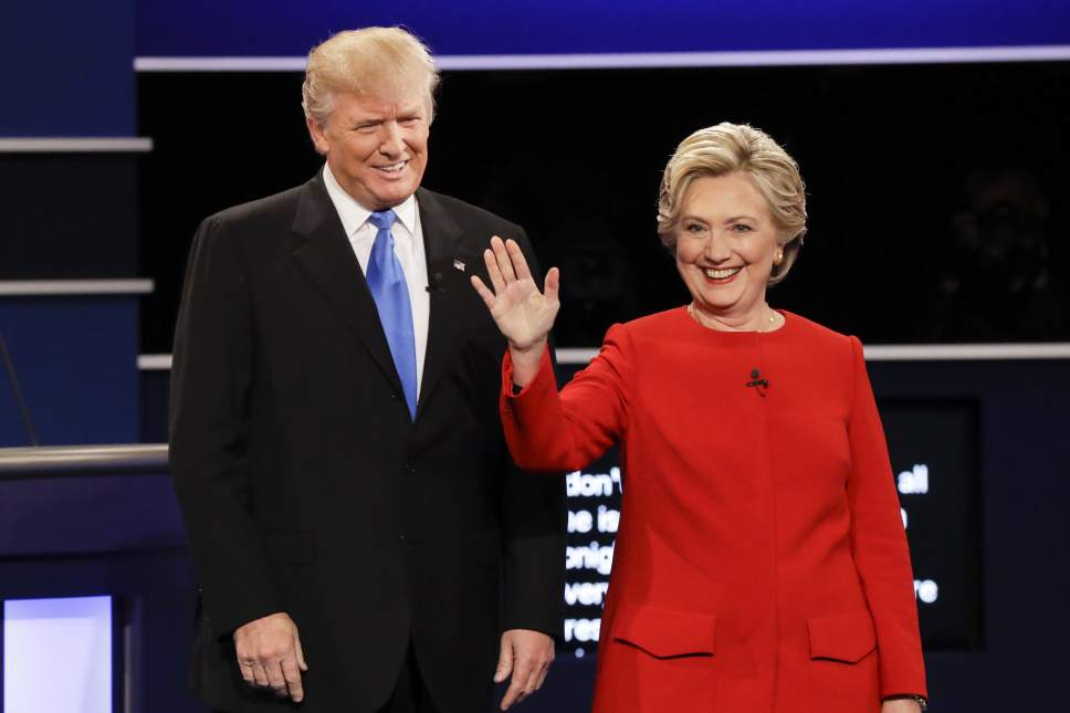 Republican presidential nominee Donald Trump and Democratic presidential nominee Hillary Clinton are introduced during the presidential debate at Hofstra University in Hempstead, N.Y., Monday, Sept. 26, 2016. (AP Photo/David Goldman)