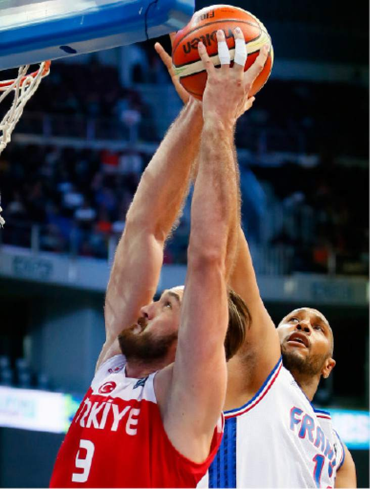 Boris Diaw of France blocks a shot by Turkey's Semih Erden, left, during their semi-final match in the FIBA Olympic Qualifying basketball Saturday, July 9, 2016 in suburban Pasay city south of Manila, Philippines. France won 75-63 to face Canada in the finals.(AP Photo/Bullit Marquez)