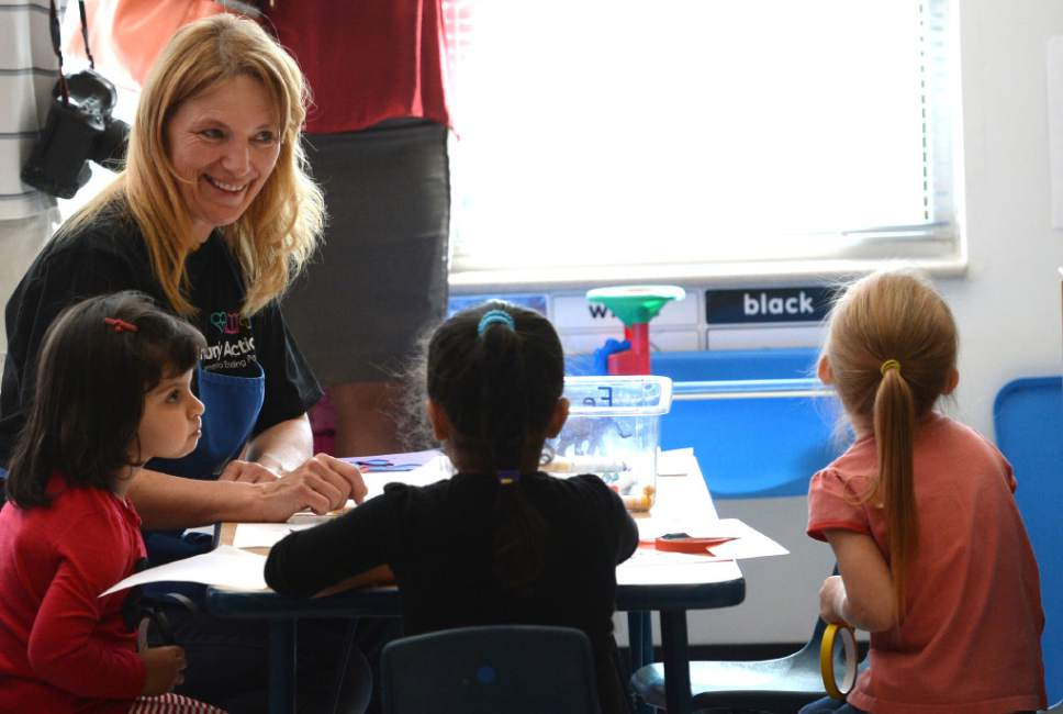 Steve Griffin / The Salt Lake Tribune   Marcela Nekutova works with her students as Lt. Gov. Spencer Cox visits a Head Start classroom as he and the Intergenerational Welfare Reform Commission officially release Utah's Fifth Annual Report on intergenerational poverty, welfare dependency and the use of public assistance during a press conference Thursday September 29, 2016. Utah is taking a unique approach to addressing intergenerational poverty by distinguishing from situational poverty and by using a two-generation approach to families by serving parents and children simultaneously in four focus areas: early childhood development, education, health and family economic stability.