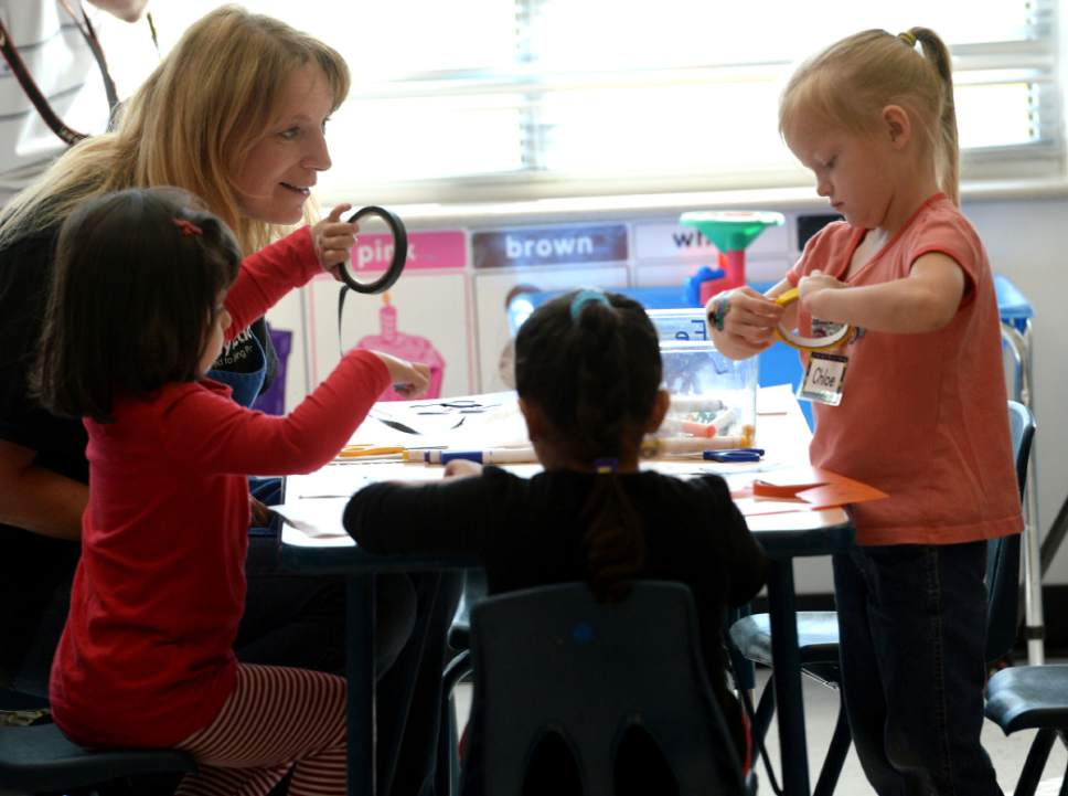 Steve Griffin / The Salt Lake Tribune   Marcela Nekutova works with her students as Lt. Governor Spencer Cox visits a Head Start classroom as he and the Intergenerational Welfare Reform Commission officially release Utahís Fifth Annual Report on intergenerational poverty, welfare dependency and the use of public assistance during a press conference Thursday September 29, 2016. Utah is taking a unique approach to addressing intergenerational poverty by distinguishing from situational poverty and by using a two-generation approach to families by serving parents and children simultaneously in four focus areas: early childhood development, education, health and family economic stability.