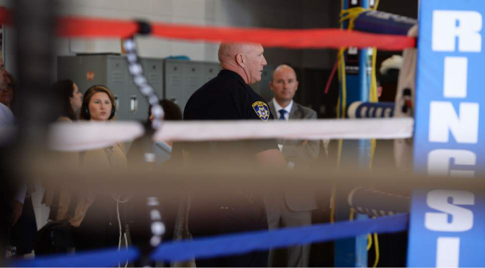 Steve Griffin / The Salt Lake Tribune   South Salt Lake City Police Chief Jack Carruth talks about the city's PAAL program in the boxing gym at the  South Salt Lake Central Park Community Center  as Lt. Governor Spencer Cox and the Intergenerational Welfare Reform Commission officially release Utah's Fifth Annual Report on intergenerational poverty, welfare dependency and the use of public assistance during a press conference Thursday September 29, 2016. Utah is taking a unique approach to addressing intergenerational poverty by distinguishing from situational poverty and by using a two-generation approach to families by serving parents and children simultaneously in four focus areas: early childhood development, education, health and family economic stability.