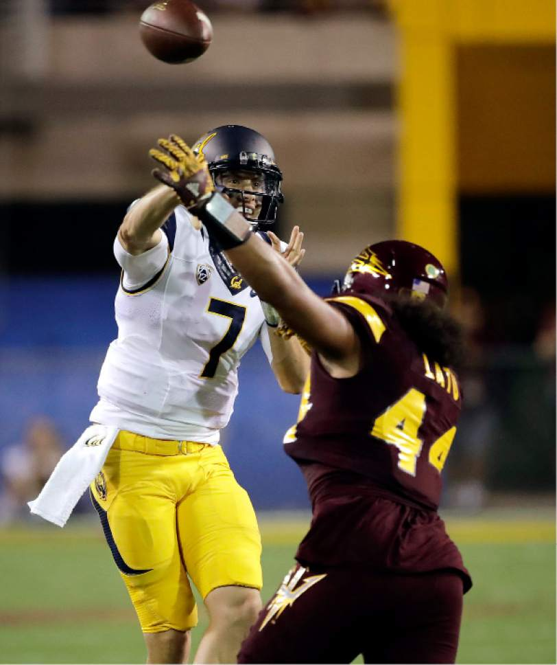 California quarterback Davis Webb (7) throws over Arizona State linebacker Alani Latu (44) during the first half of an NCAA college football game, Saturday, Sept. 24, 2016, in Tempe, Ariz. (AP Photo/Matt York)