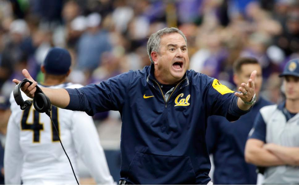 FILE - In this Sept. 26, 2015, file photo, California head coach Sonny Dykes reacts to a call by officials during the first half an NCAA college football game against Washington in Seattle. Dykes father, Spike Dykes, was a coach for the Texas Tech football team. (AP Photo/Elaine Thompson, file)
