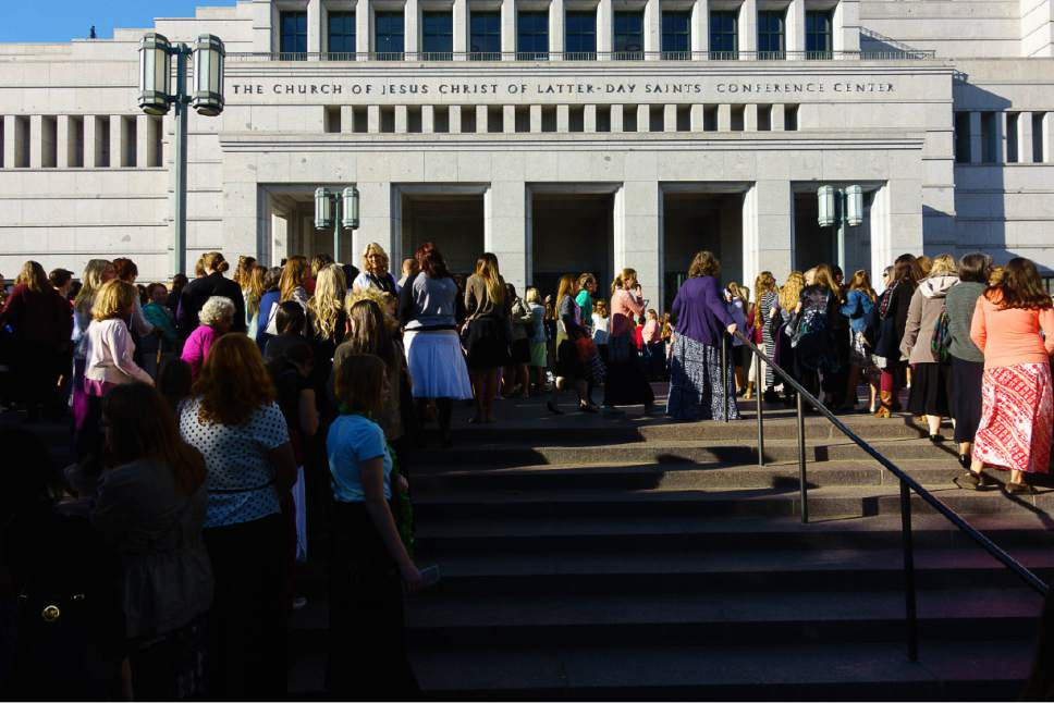 Trent Nelson  |  The Salt Lake Tribune Women arrive at the Conference Center for the General Women's Session of the 186th Semiannual General Conference, in Salt Lake City, Saturday September 24, 2016.
