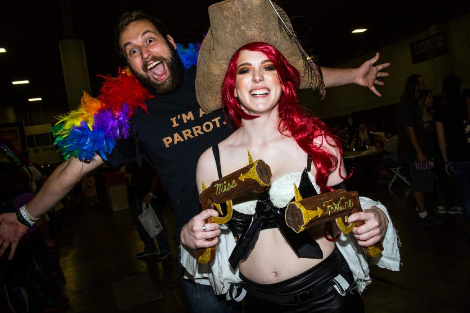 Chris Detrick  |  The Salt Lake Tribune Liz Marx and James Henderson, of Ogden, pose for a portrait as Miss Fortune and a parrot during Salt Lake Comic Con at the Salt Palace Convention Center Saturday September 3, 2016.