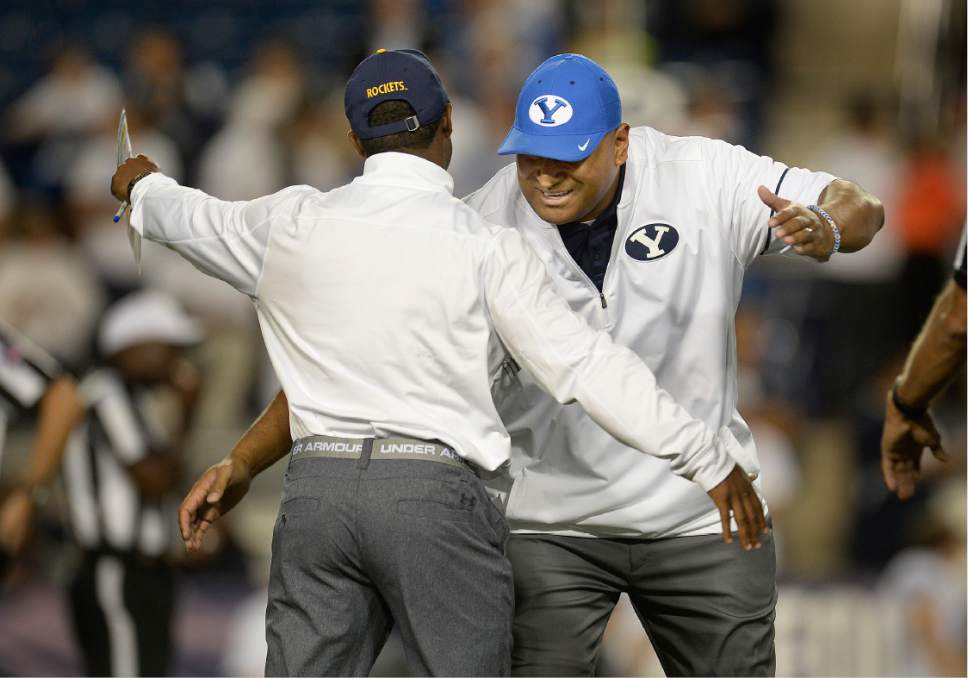 Scott Sommerdorf   |  The Salt Lake Tribune   Brigham Young Cougars head coach Kalani Sitake greets a Toldeo coaching acquaintance prior to kickoff. BYU led Toledo 21-14 at the end of the 1st quarter, Friday, September 30, 2016.