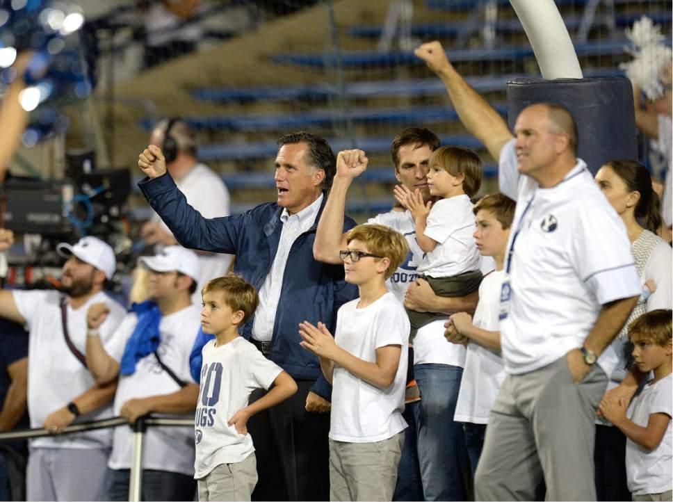 Scott Sommerdorf      The Salt Lake Tribune   BYU alum Mitt Romney sings the BYU fight song during pre-game ceremonies. BYU led Toledo 21-14 at the end of the 1st quarter, Friday, September 30, 2016.