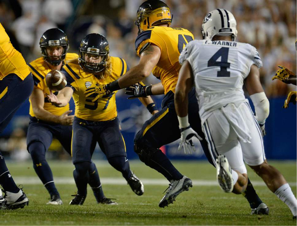 Scott Sommerdorf   |  The Salt Lake Tribune   Toledo Rockets place kicker Jameson Vest (37) reached out to grab the ball after his field goal was blocked late in the first half. BYU and Toledo were tied 21-21 at the half, Friday, September 30, 2016.