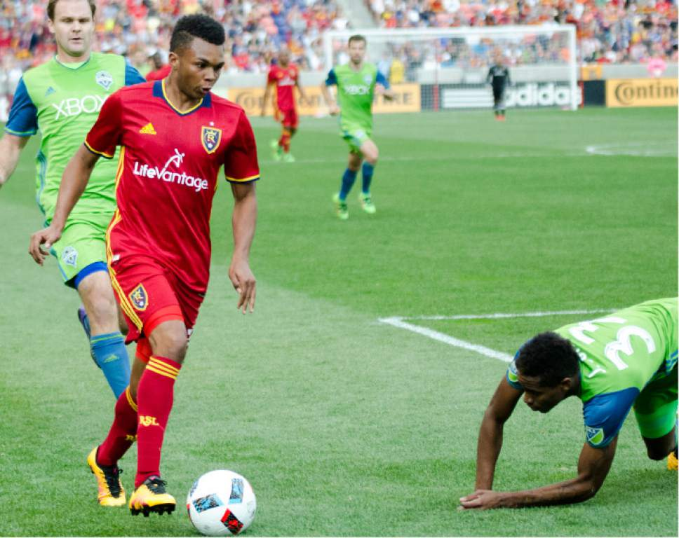 Taner Pasamehmetoglu  |  RSL  Midfielder Jordan Allen dribbles by Seattle defenders Joevin Jones and Chad Marshall in RSL's 2-1 win over the Sounders on March 12.