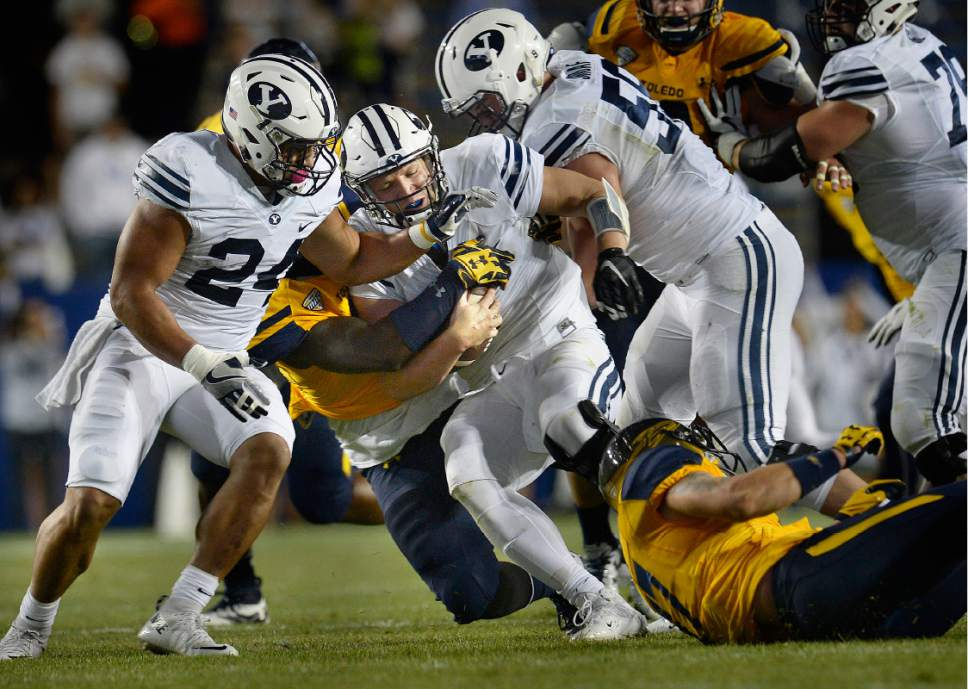 Scott Sommerdorf   |  The Salt Lake Tribune   Toledo Rockets defensive end Olasunkanmi Adeniyi, sacks BYU QB Taysom Hill late in the first half. BYU and Toledo were tied 21-21 at the half, Friday, September 30, 2016.