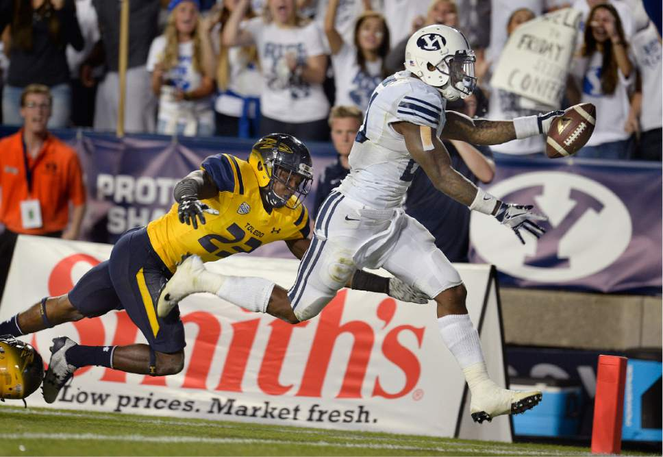 Scott Sommerdorf   |  The Salt Lake Tribune   BYU RB Jamaal Williams (21) stretches for his fourth TD of his five TD runs as BYU defeated Toledo 55-53, Friday, September 30, 2016. Williams finished with a BYU record for total yards rushing with 286.