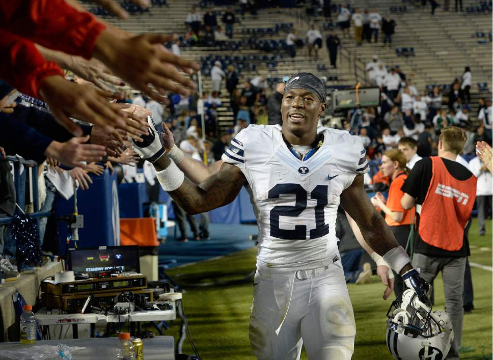 Scott Sommerdorf   |  The Salt Lake Tribune   BYU RB Jamaal Williams (21) celebrates with fans after  BYU defeated Toledo 55-53, Friday, September 30, 2016.
