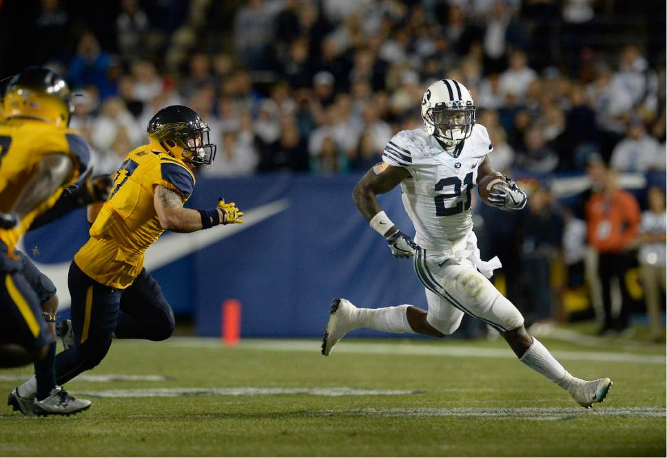 Scott Sommerdorf   |  The Salt Lake Tribune   BYU RB Jamaal Williams (21) runs for some of his 286 yards rushing as BYU defeated Toledo 55-53, Friday, September 30, 2016. Williams also scored 5 TDs.