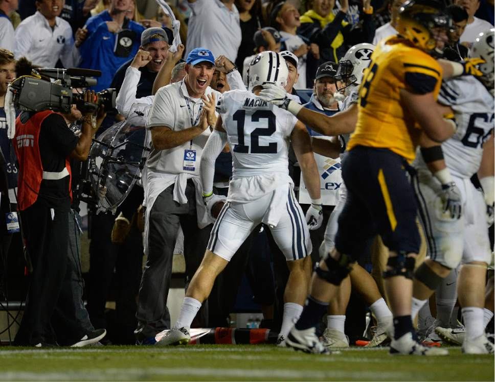 Scott Sommerdorf   |  The Salt Lake Tribune   The BYU sideline celebrates BYU defensive back Kai Nacua's fourth quarter interception. BYU defeated Toledo 55-53, Friday, September 30, 2016.