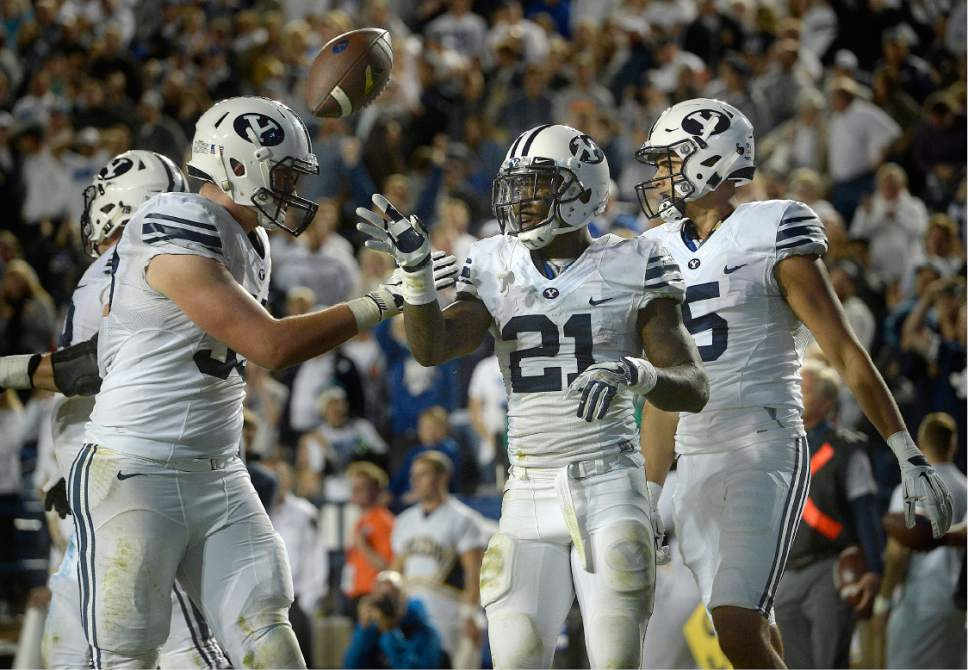 Scott Sommerdorf   |  The Salt Lake Tribune   BYU RB Jamaal Williams (21) flips the ball away after a scoring run that was nullified by a holding penalty during second half play. Williams finished with 286 yards rushing and 5 TDs. TD runs as BYU defeated Toledo 55-53, Friday, September 30, 2016.