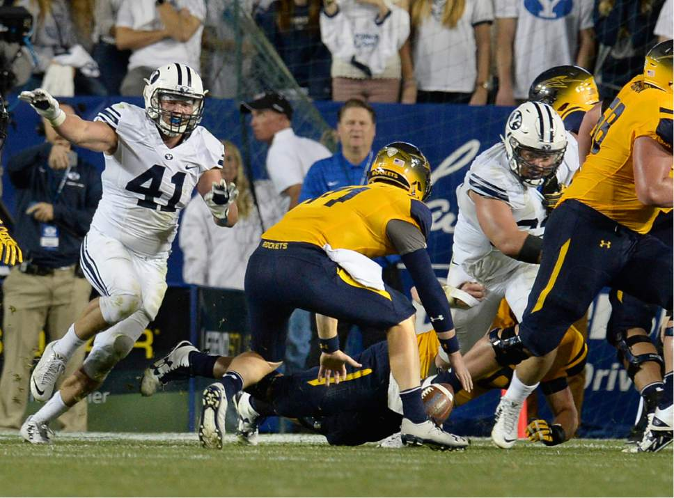Scott Sommerdorf   |  The Salt Lake Tribune   Toledo Rockets quarterback Logan Woodside (11) picks up a fumbled snap on a successful 2 point conversion attempt that gave the Rockets a brief 53-52 fourth quarter lead. BYU defeated Toledo 55-53, Friday, September 30, 2016.