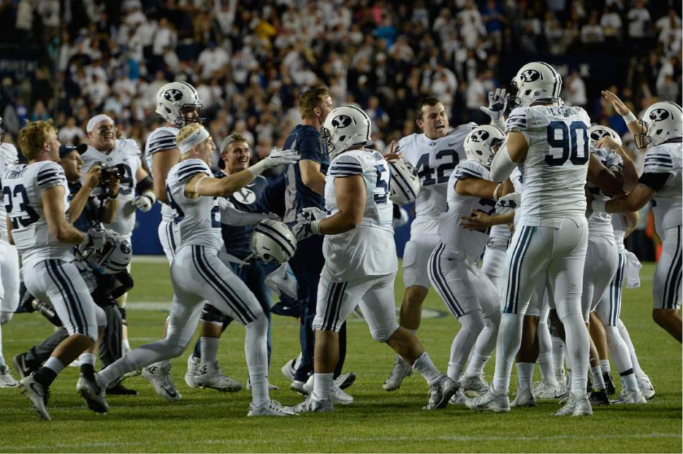 Scott Sommerdorf   |  The Salt Lake Tribune   BYU Players celebrate the winning filed goal as BYU defeated Toledo 55-53, Friday, September 30, 2016.