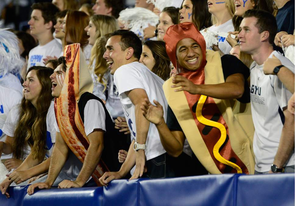 Scott Sommerdorf   |  The Salt Lake Tribune   Fans dressed as bacon and a hot dog are among others enjoying the high-scoring shootout between BYU and Toledo. BYU defeated Toledo 55-53, Friday, September 30, 2016.