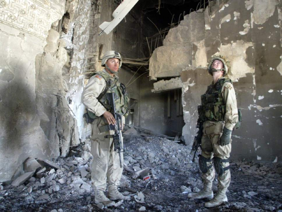 Soldiers from the 1-22 Fourth Infantry Division inspect home of Saddam Hussein's first wife Sajida Talfah near Tikrit on Thursday, Nov. 20, 2003. In the first days of the invasions many of the homes used by Saddam Hussein and his family were targeted by missiles. (AP Photo/Efrem Lukatsky)