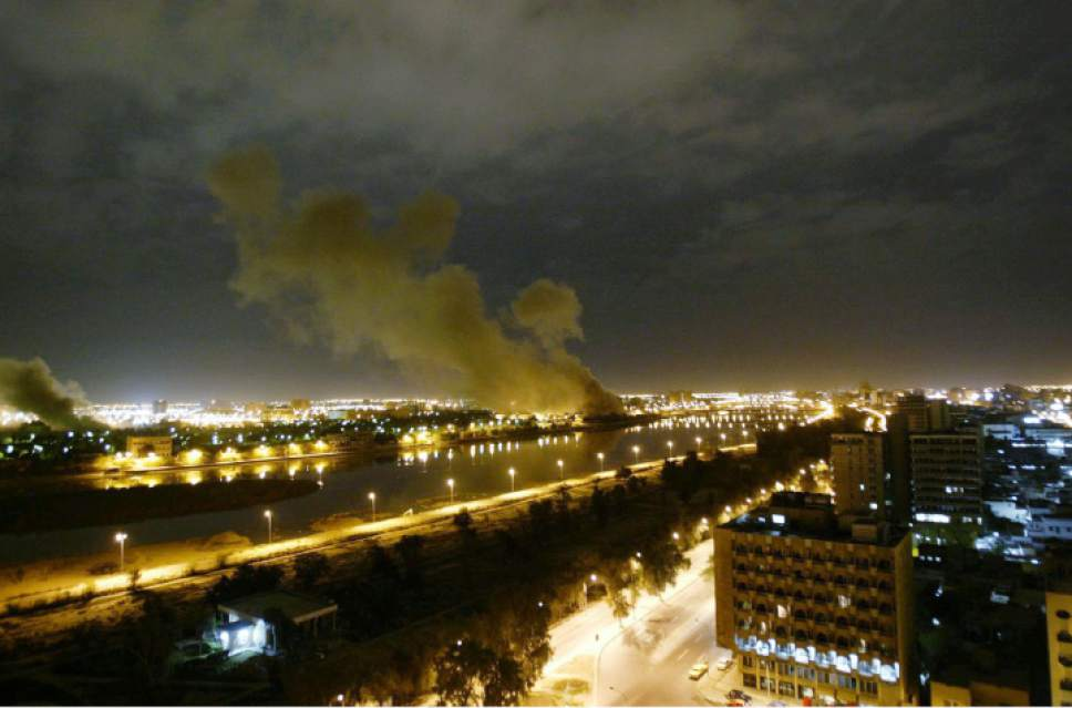 ** FOR USE AS DESIRED WITH MARCH 20, 2003 ANNIVERSARY OF THE U.S.-LED INVASION OF IRAQ** FILE **  Smoke rises from the Trade Ministry in Baghdad March 20, 2003 after it was hit by a missile during US-led forces attacks. Four years into the Iraq war, Presiden Bush is staring down a Congress in revolt. He's bucking public opinion by sending some 30,000 more U.S. soldiers to Baghdad. (AP Photo/Jerome Delay)
