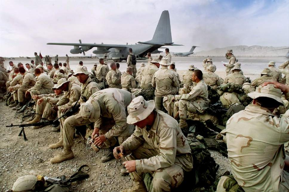 Pablo Martinez Monsivais     AP file photo U.S. Marines sit along the runway of the airbase in Kandahar, Afghanistan,in Jan. 2002 as they withdraw to be replaced by the Army's 101st Airborne division. After two turns at combat in Iraq, first as invaders in the 2003 march to Baghdad and later as occupiers of landlocked Anbar province, the Marines left Iraq in early 2010 to reinforce the fight in southern Afghanistan.
