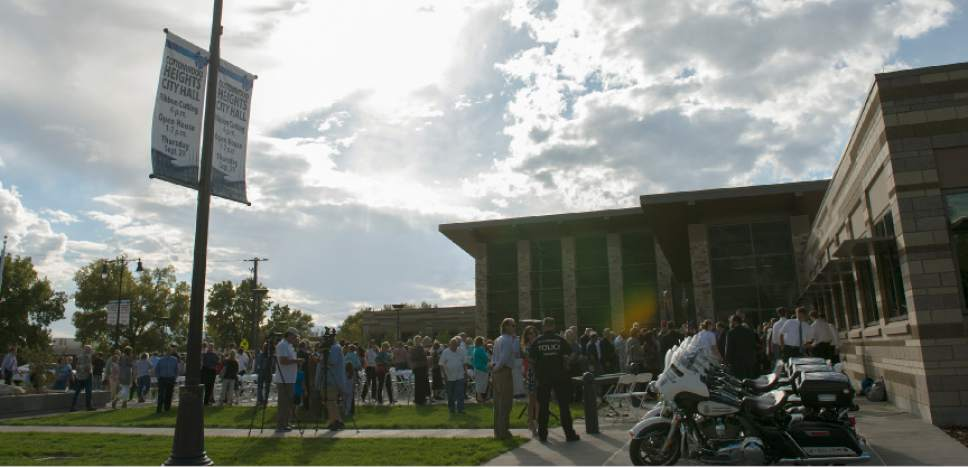 Leah Hogsten  |  The Salt Lake Tribune  Cottonwood Heights City Hall officials, dignitaries and residents celebrated its official opening with an open house and ribbon cutting September 29, 2016.